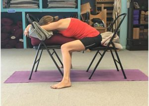 Women doing yoga to help relieve back pain.