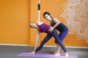 practicing yoga to alleviate back pain