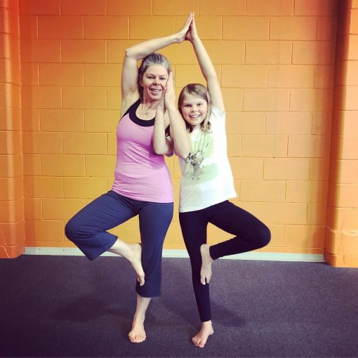 Mother and Daughter Posing in a Family Yoga Class